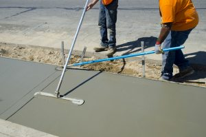 Workers laying concrete for a foundation in Roanoke